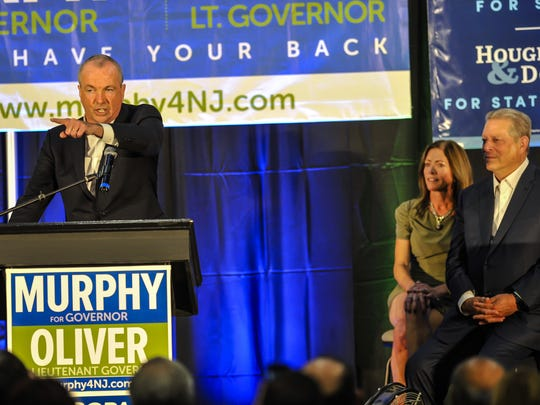 NJ Governor candidate Phil Murphy addresses the crowd as former Vice President Al Gore looks on at the Ocean Twp. Municipal Gym in Ocean on Sunday Oct. 15, 2017.