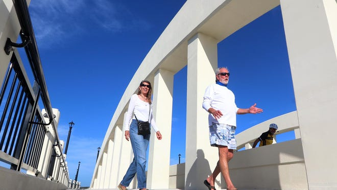 After waiting for construction to wrap up on the new Orange Avenue bridge for more than four years, local residents were thrilled to take their first walk across the concrete span Thursday morning.