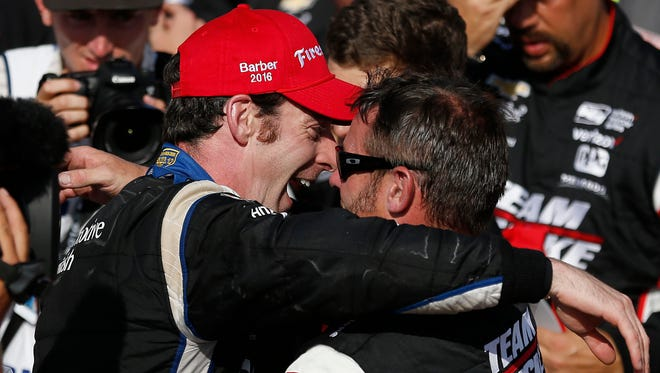 Simon Pagenaud (left)  hugs a  teammate after winning the Indy Grand Prix of Alabama auto race on Sunday in Birmingham, Ala.