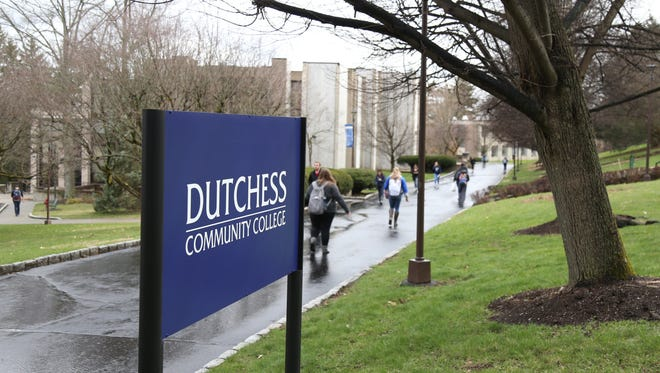 Students walk to and from at Dutchess Community College on April 19, 2018.