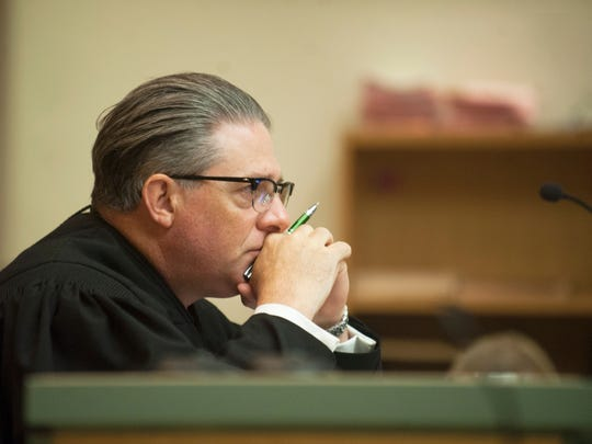 Judge Joseph M. Chiarello listens as Cumberland County Assistant Prosecutor Lesley Snock speaks during the detention hearing of double-murder suspect Daniel Brennan in Cumberland County Superior Court in Bridgeton on Monday, August 6, 2018.  Brennan did not appear during the hearing.