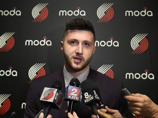 CORRECTS NAME OF THE PLAYER TO JUSUF NURKIC, INSTEAD OF NIKOLA JOKIC - Newly acquired Portland Trailblazer Jusuf Nurkic speaks with the media before the start of an NBA basketball game between the Atlanta Hawks and the Portland Trailblazer in Portland, Ore., Monday, Feb. 13, 2017. (AP Photo/Steve Dykes)