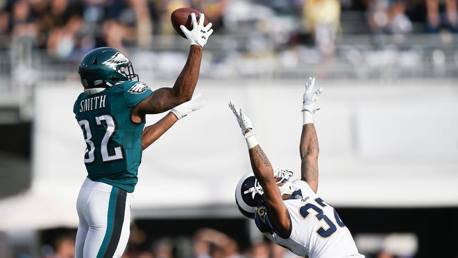 Eagles wide receiver Torrey Smith, left, is unable to make a catch while being defended by Rams cornerback Troy Hill last Sunday. Hill, a St. Bonaventure High graduate, is expected to be on the field plenty this Sunday at Seattle.