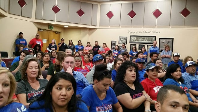 Supporters of the Las Cruces High, Mayfield High, Centennial High and Oñate High football programs attended a Las Cruces Public Schools board meeting Tuesday evening in Las Cruces to express their views on a proposed football doubleheader. LCPS Superintendent Greg Ewing announced a revision to his initial proposal that satisfied the concerns of many attendees.