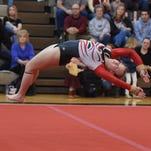 McCutcheon gymnasts defend Jeff Sectional title