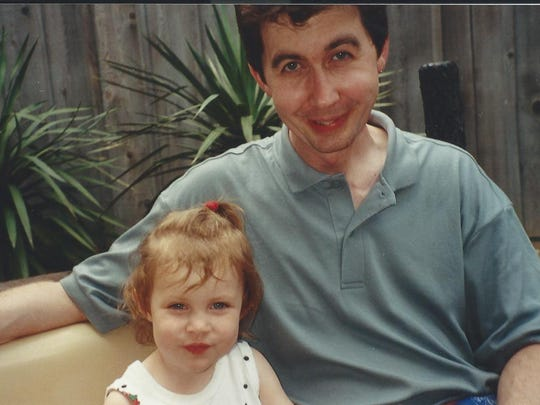 An undated photo of Jeff Benson with then-infant daughter, Krysta.
