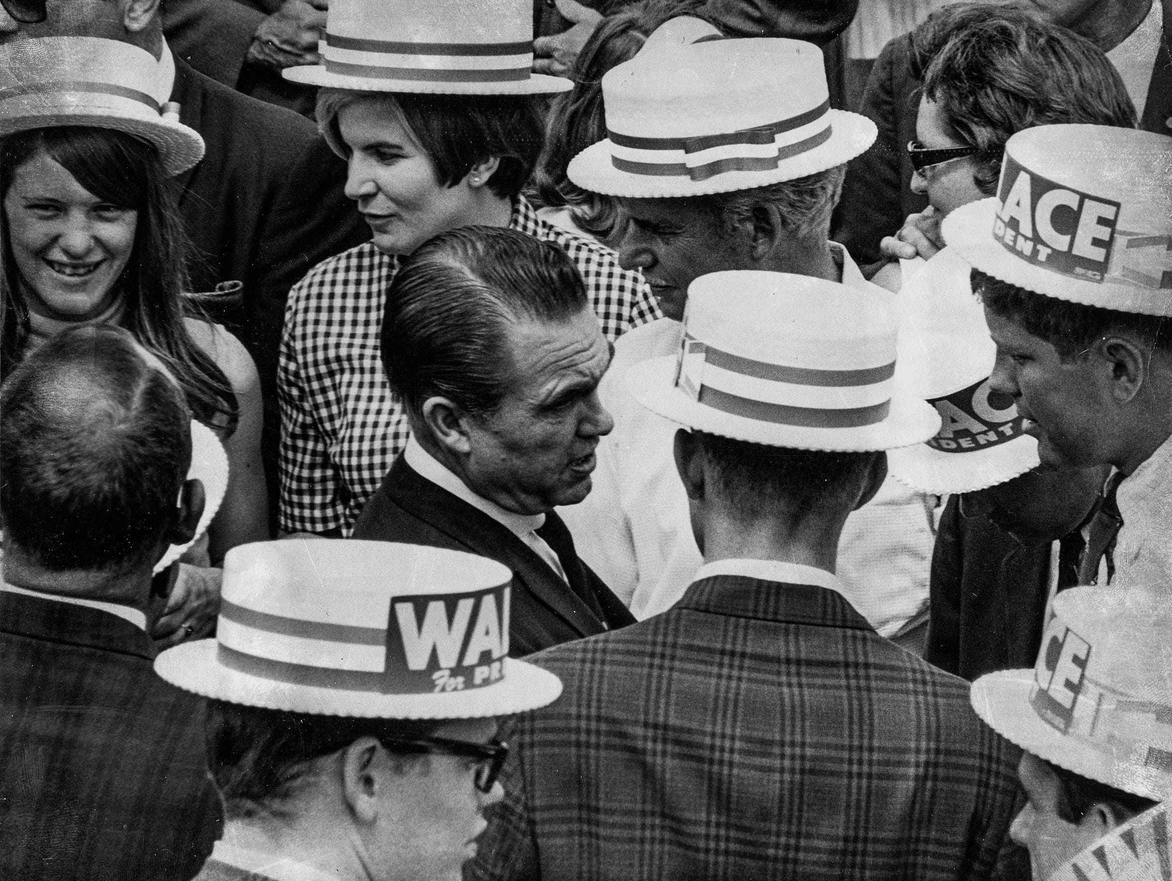 Presidential candidate George Wallace talks with college