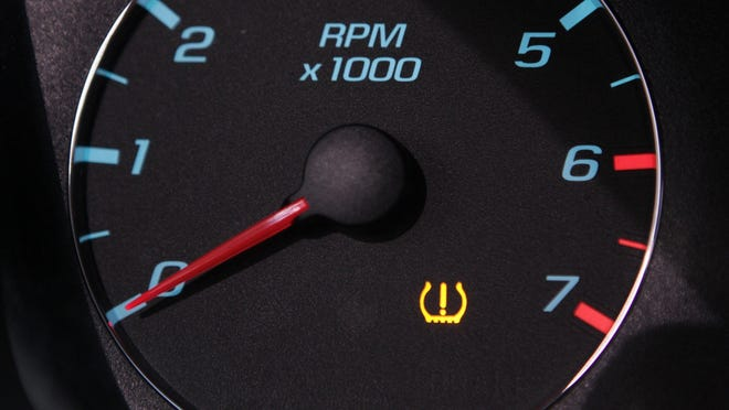 Tire Pressure Monitoring System icon, which indicates a tire may need to be checked, can look like a bag holding an exclamation point.