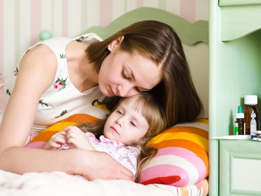 mother embraces the sick child