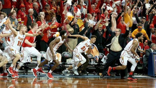 Ferris State's bench erupts as the buzzer sounds in the Bulldogs' 71-69 win over Northern State in the NCAA Division II men's college basketball championship game on Saturday.