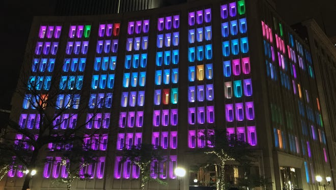 """A photo of Brooklyn-based artist Amanda Browder's """"At Night We Light Up,"""" a digital light display on the side of the Indianapolis Power & Light building to announce the Central Indiana Community Foundation's two-day light festival, IN Light IN."""
