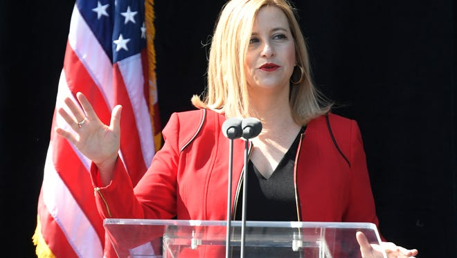 Mayor Megan Barry does a sound check before delivering her second State of Metro address Wednesday, April 26, 2017 at Bridgestone Arena in Nashville, Tenn.
