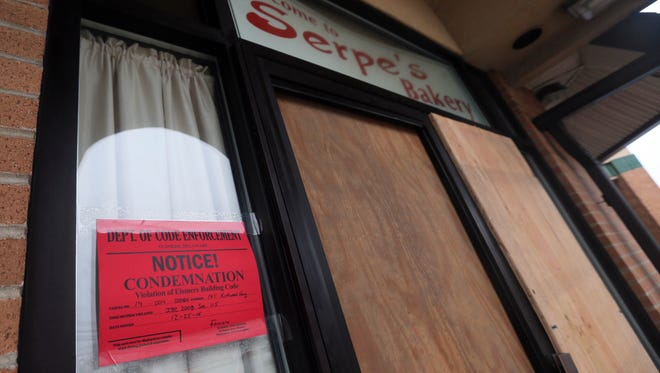 The front doors of Serpe's Bakery in Elsmere are boarded up on Friday, following a fire that badly damaged the structure. Tony Serpe, one of the bakery's owners, said he plans to rebuild.