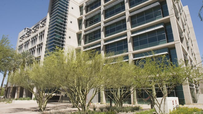 TGen will buy the city-owned building after an earlier deal fell through.