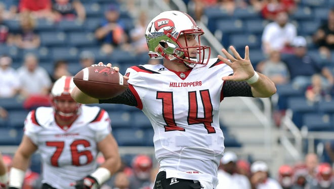 Oct 29, 2016; Boca Raton, FL, USA; Western Kentucky Hilltoppers quarterback Mike White (14) throws a pass during the first half against the Florida Atlantic Owls at FAU Football Stadium. Mandatory Credit: Steve Mitchell-USA TODAY Sports