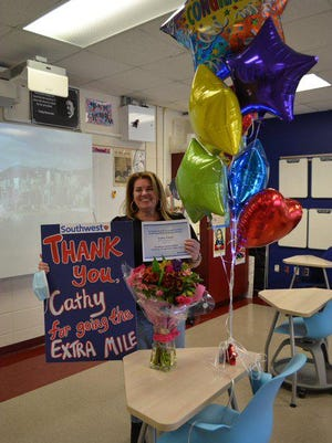 Westlake history teacher Cathy Cluck was recognized by Southwest Airlines on Friday for her 1,500-mile American history road trip in August that she used to keep students engaged while they were learning remotely.