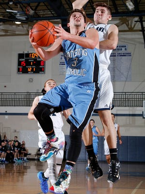 Lansing Catholic's Matthew Fata, shown in a game earlier this week, was one of Thursday's top performers in the area.