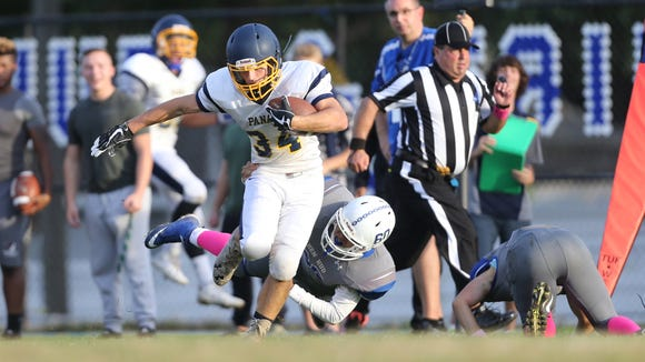 Panas' Sean Laukaitis (34) works to break a tackle