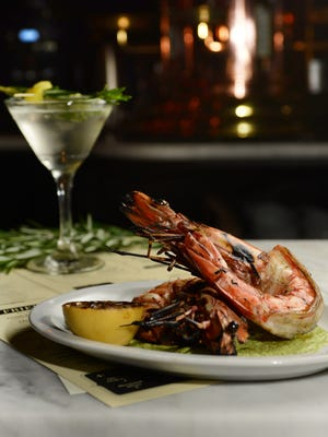 Rosemary-garnished drink and Rosemary's Baby and Grilled Gambas at Porta in Jersey City.
