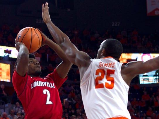 Louisville Cardinals guard Darius Perry (2) shoots