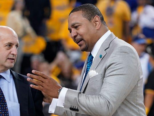 Mark Jackson, right, talks with Jeff Van Gundy before Game 4 of basketball's NBA Finals between the Golden State Warriors and the Toronto Raptors in Oakland, Calif., Friday, June 7, 2019. ABC/ESPN NBA analyst Jackson credits faith, confidence and longtime friendships with Van Gundy and Mike Breen as the main catalysts for his longevity and why he is working his 12th NBA Finals. (AP Photo/Tony Avelar)