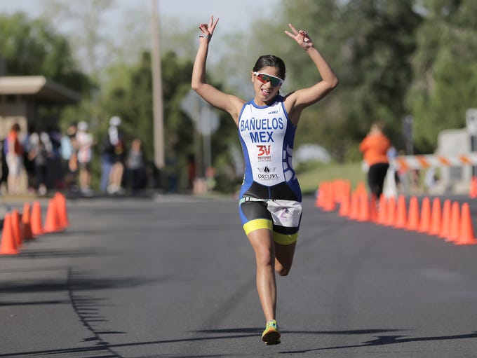 Itzel Banuelos of Mexico crosses the finish line to