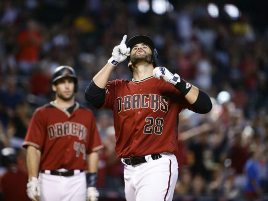 J.D. Martinez points to the sky after hitting his second