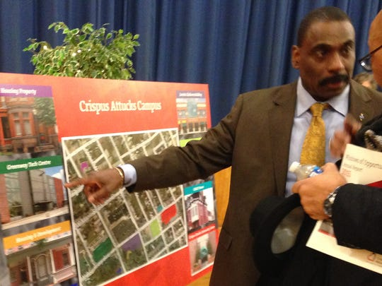 Crispus Attucks Community Center's Bobby Simpson indicates the extent of CA's south side York campus at the organization's 2016 annual meeting. CA started in 1931, and the community social service and recreation association met at the nurses' quarters of the old York Hospital on College Avenue. CA has grown from that single site to a sprawling campus that includes at least eight major buildings.