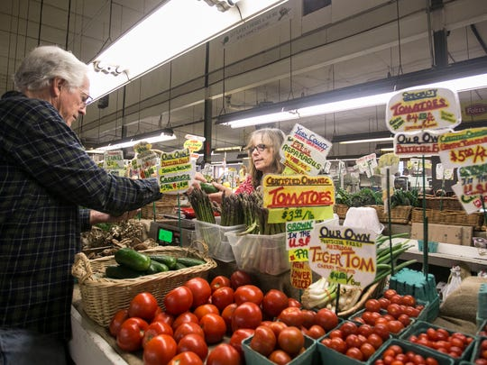 Brogue Hydroponics employee Bridget Woltman, of Red Lion, helps Harl Hughes, Glenville, with his purchase Friday, April 29, 2016, at  New Eastern Market Co. Amanda J. Cain photo