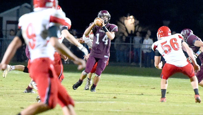 Still on the move, Stuarts Draft quarterback Trevor Craig looks to pass deep downfield even as Riverheads defenders move around him during the final seconds of a football game played in Stuarts Draft on Friday, Sept. 8, 2017.