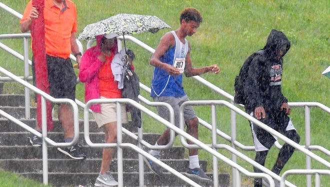 People again file out of the stadium for a second time after thunder and lightening cause another storm delay at the Group 3A state track and field championships held in Harrisonburg on Saturday, June 2, 2018.