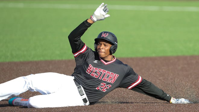 Detroit Western center fielder William English slides in to second base during the game on Wednesday, April 25, 2018, at Country Day.