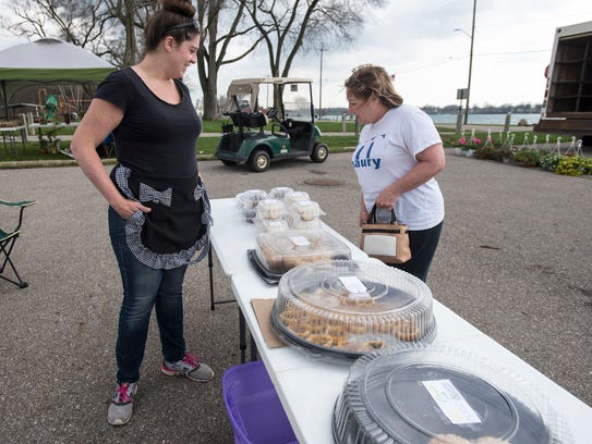 Carol Hanba, right, browses the baked goods at Shannon