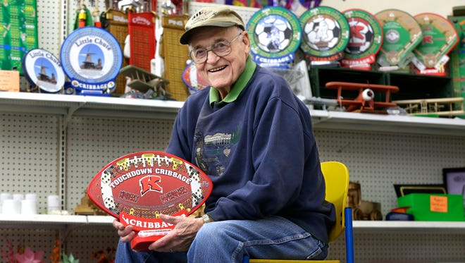 Gib Miller, 88, of Appleton shows off his custom made cribbage boards Monday, March 7, 2016, at Part and Print in Little Chute.