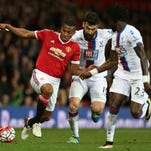 Manchester United's Antonio Valencia (L) in action