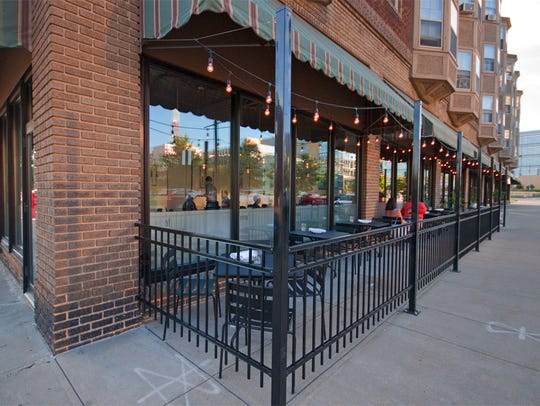 Proof just added a patio on the sidewalk over the summer.