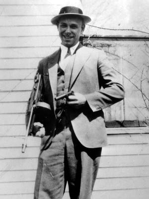 This is a 1934 photo of desperado John Dillinger near Moore Ind. (AP Photo)