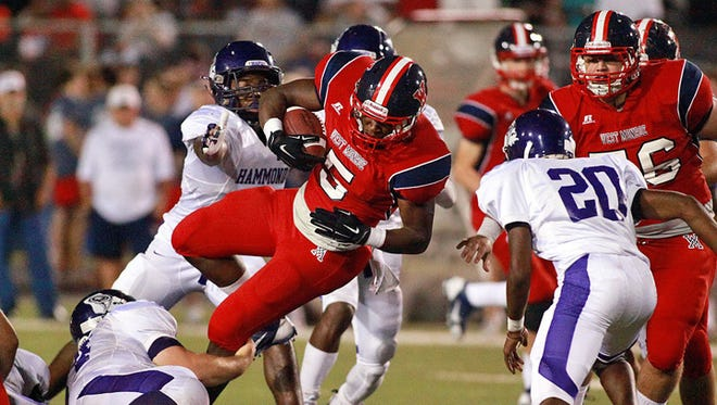 The West Monroe Rebels battle the Hammond Tornadoes Friday night on Don Shows Field at Rebel Stadium.