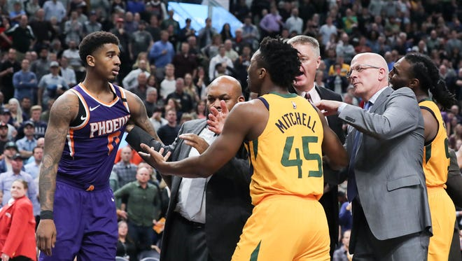 Mar 15, 2018; Salt Lake City, UT, USA; Security tries to keep Phoenix Suns forward Marquese Chriss (0) and Utah Jazz guard Donovan Mitchell (45) separated during the second half at Vivint Smart Home Arena. Utah Jazz won 116-88. Mandatory Credit: Chris Nicoll-USA TODAY Sports
