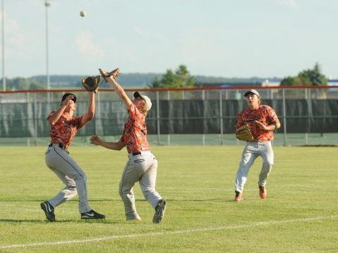 Plymouth first baseman Jake Steinhardt, center, and second baseman Cole Karcewski, left, go after a pop-up as right fielder Drew Schweiger backs up the play in the third inning against Sheboygan Lutheran/Kohler in a WIAA regional final on Friday.
