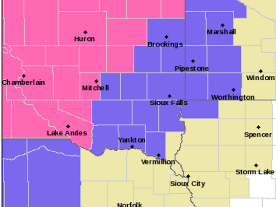 Warning map from NWS: Pink = Winter Storm Warning. Purple = Winter Weather Advisory. Yellow = Hazardous Weather Outlook. As of 7:07 a.m. Tuesday