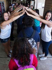 Members of Kappa Delta sorority from Florida Gulf Coast University greet Lehigh Acres Middle School students back classes after a long lay off due to Hurricane Irma. The sorority along with dozens of others from various sororities and fraternities along with staff members greeted the students back.