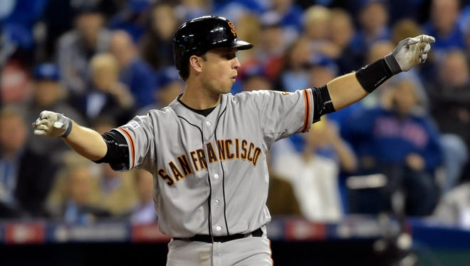 Buster Posey reacts as he loses his bat on a swing against the in the sixth inning of Game 6.