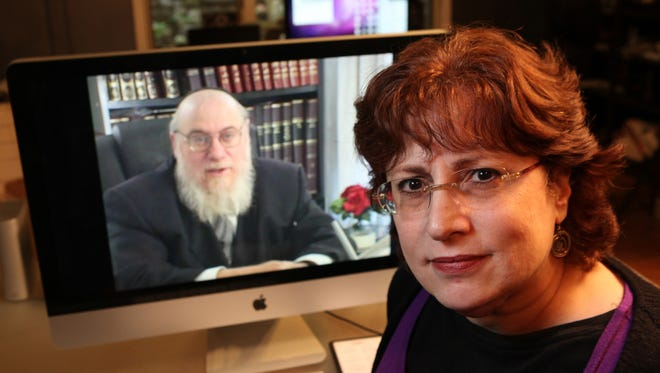 An image from the documentary filmmaker Leta Lenik made about Jewish women and divorce is displayed. Rabbi Mendel Epstein, visible on the screen, was interviewed for the film. He was arrested Wednesday, Oct. 9, 2013, as part of an FBI investigation into a Jewish divorce gang.