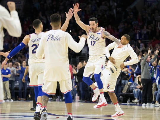 Philadelphia 76ers guard JJ Redick (17) reacts after