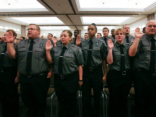 MDOC officers are sworn in Friday, August 14, 2015, during the Michigan Department of Corrections commencement ceremony at the Lansing Center in downtown Lansing.