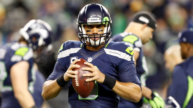Russell Wilson has led the Seahawks to an NFL-best 11-1 record this season and the inside track for home-field advantage in the NFC playoffs.