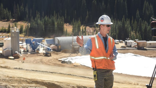 Steve Way, on-scene coordinator for the EPA, stands in front of the new facility on Thursday, Oct. 15, 2015, north of Silverton, Colo., that will treat water coming out of the Gold King Mine  by adding lime to raise the pH before separating solids from liquids. Way said the treated water will be released into Cement Creek. (Steve Lewis/Durango Herald via AP)
