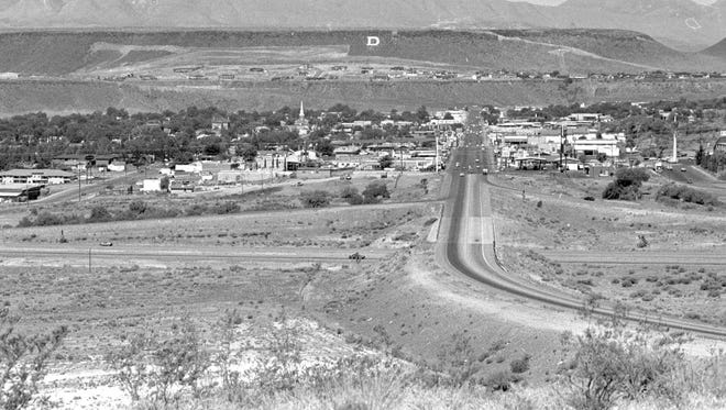 In June of 1988 when the then image was taken by Spectrum photographer Nancy Rhodes, St. George Boulevard ended at the onramp for Exit 8 on Interstate 15. the section of the Boulevard that can be seen crossing the bridge over the freeway and then curving towards the bottom right of the image simply carried drivers to and from the northbound lanes of the interstate. 25 years after the then image was captured, in 2013, construction began on the new diverging diamond interchange that can be seen in the now image taken by Spectrum photographer Jud Burkett. St. George Boulevard has long since made the connection to River Road and the myriad of shops and stores that have sprung up in the ensuing years on the east side of the freeway. In addition to the roofs and signs of a few of those shops and stores like Chuck-A-Rama, the Brick Oven and the St. George Food Market and Chevron, on the west side oft freeway, Bracken's Auto Tech along with a couple of shopping and office complexes has been built south of St. George Boulevard.