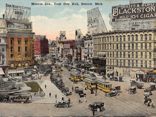 The postcard of Monroe Avenue from City Hall can be